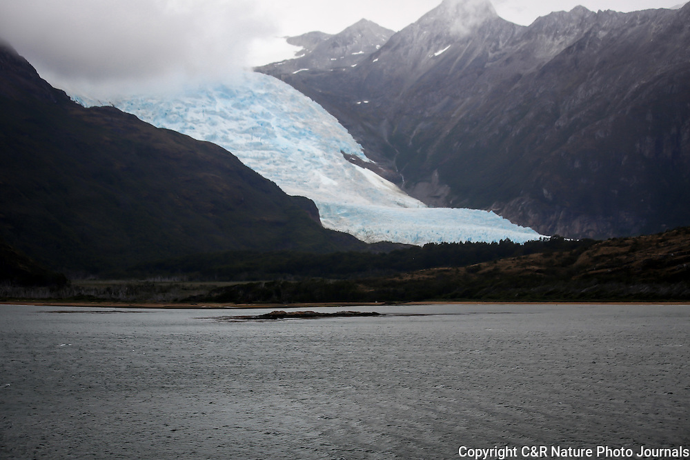 The Amalia Glacier displays the blue ice that we were told is due to the oxygen trapped within it's structure.  The landscape was enhanced by the mountains and the low hanging clouds this morning.