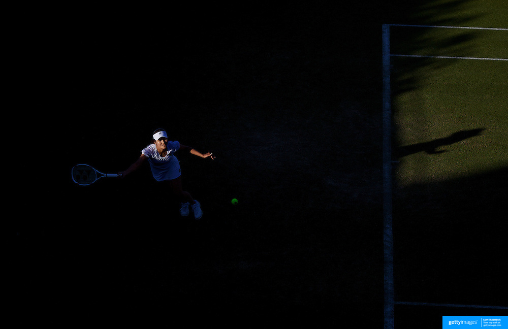 Akiko Morigami, Japan  in action against Svetlana Kuznetsova, Russia,  in the late eveing light  during the first round match at the All England Lawn Tennis Championships at Wimbledon, London, England on Tuesday, June 23, 2009. Photo Tim Clayton.