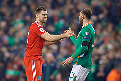 DUBLIN, REPUBLIC OF IRELAND - Friday, March 24, 2017: Wales' Sam Vokes and Republic of Ireland's Richard Keogh after the goal-less draw during the 2018 FIFA World Cup Qualifying Group D match at the Aviva Stadium. (Pic by David Rawcliffe/Propaganda)