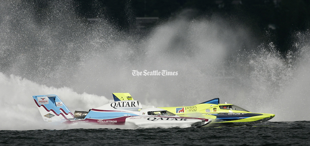 Dave Villwock, of Auburn, driving the Spirit of Qatar, passes Brian Perkins, of Black Diamond, in the Miss Peters &amp; May boat, before finishing second at the Albert Lee Cup at Seafair in Seattle on Sunday, August 8, 2010. <br /> Seattle Times staff photographer
