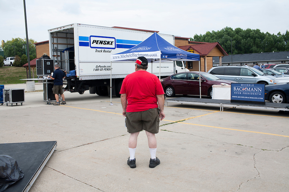 A man watches as platforms are broken down following a campaign appearance by Republican presidential hopeful Michele Bachmann on Friday, August 5, 2011 in Newton, IA.