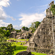 Temple 1, also known as the Temple of the Great Jaguar or Temple of Ah Cacao in the Tikal Maya ruins in northern Guatemala, now enclosed in the Tikal National Park. At the left of frame is the Main Plaza. On the side of the temple is some of the scaffolding that archeologists are using to restore the temple.