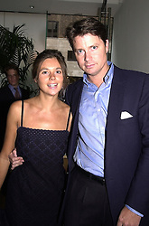 Social figure DR MARK CECIL and MISS KATIE ANGEL,<br />   at a party in London on 28th June 2000.OFW 26<br /> © Desmond O'Neill Features:- 020 8971 9600<br />    10 Victoria Mews, London.  SW18 3PY <br /> www.donfeatures.com   photos@donfeatures.com<br /> MINIMUM REPRODUCTION FEE AS AGREED.<br /> PHOTOGRAPH BY DOMINIC O'NEILL