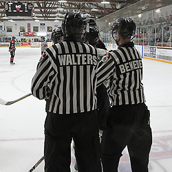"""TRENTON, ON  - MAY 5,  2017: Canadian Junior Hockey League, Central Canadian Jr. """"A"""" Championship. The Dudley Hewitt Cup. Game 7 between Georgetown Raiders and the Powassan Voodoos. The linesman break up an  altercation during the first period.<br /> (Photo by Tim Bates / OJHL Images)"""