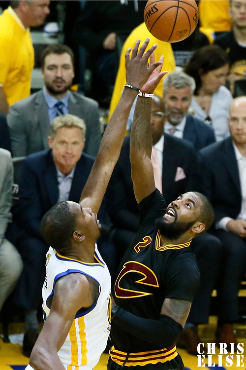 04 June 2017: Cleveland Cavaliers guard Kyrie Irving (2) goes for the layup over Golden State Warriors forward Kevin Durant (35) during the Golden State Warriors 132-113 victory over the Cleveland Cavaliers, in game 2 of the 2017 NBA Finals, at the Oracle Arena, Oakland, California, USA.