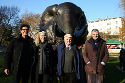 © Licensed to London News Pictures. 04/12/2019. London, UK. Artists MARC (L), GILLIE (2nd from left), Author and father of the Prime Minister BORIS JOHNSON, STANLEY JOHNSON (2nd from Right) and Parliamentary Conservative candidate for Richmond Park and North Kingston and former Tory candidate for Mayor of London ZAC GOLDSMITH (R) pose with a bronze elephant during the unveiling of life-sized herd of 21 elephants at Marble Arch.<br /> at Marble Arch. The sculpture is the largest such depictionof an elephant herd in the world and is intended to draw attention to the plight of this species that could be extinct on current trends, by 2040. Each elephant in the sculpture is modelled after a real orphaned animal currently in the care of the Sheldrick Wildlife Trust. Left behind by poachers and other sources of human-wildlife conflict these animals have been raised by the trust in an effort to secure the future of the species. The herd will be displayed until 4 December 2020. Photo credit: Dinendra Haria/LNP