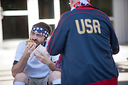 USA fans grab a bite to eat on Occidental Ave S before the USA vs. Panama Men's Soccer - FIFA World Cup qualifying match between the USA and Panama Tuesday, June 11, 2013 at CenturyLink Field in Seattle, WA.