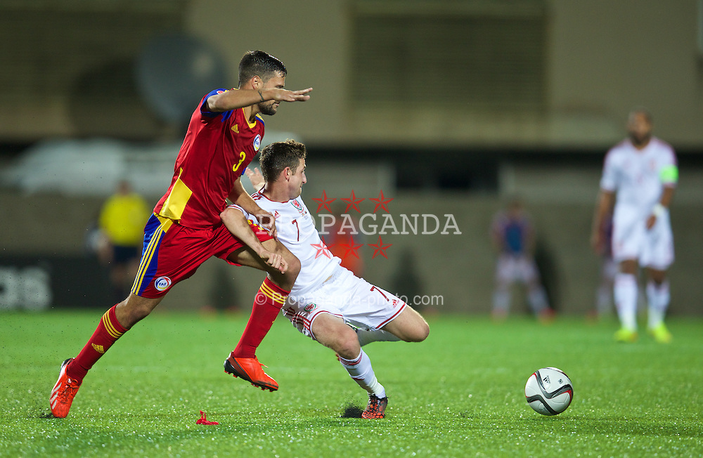 ANDORRA LA VELLA, ANDORRA - Tuesday, September 9, 2014: Wales' Joe Allen in action against Andorra's Marc Vales Gonzalez during the opening UEFA Euro 2016 qualifying match at the Camp d'Esports del M.I. Consell General. (Pic by David Rawcliffe/Propaganda)