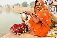 Portrait of a smiling woman wearing a colorful saree, Varanasi, India. Exotic people and places photography prints and wall art for sale.
