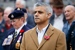 © Licensed to London News Pictures. 11/11/2015. London, UK. Labour's Mayor of London candidate Sadiq Khan observing a two minutes silence in Trafalgar Square during Silence in the Square event as part of Armistice Day on Wednesday, 11 November 2015. Photo credit: Tolga Akmen/LNP