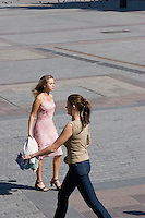 Women walking on the Rynkek in Krakow Poland