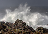 Storm waves crashing onto shore near Amphitrite Lighthouse, Wild Pacific Trail, Ucluelet, British Columbia, Canada