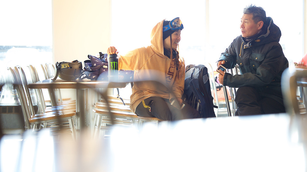 Chloe Kim talks with her father Jong Kim in the Jack's cafeteria during a mid morning break from the pipe at Copper Mountain, CO. ©Brett Wilhelm/ESPN