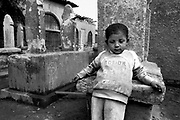 Cairo, Egypt, The City of the Dead, 2000 - A young boy home who hasn't gone to school that day.