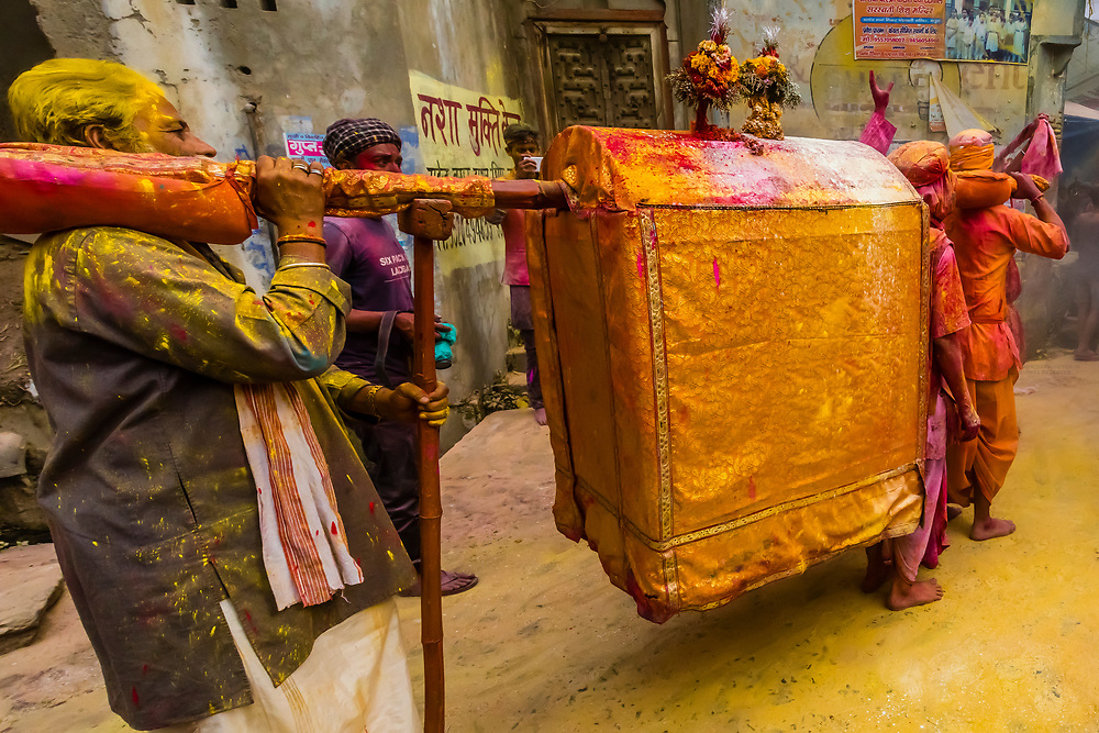 Procession during Chhadi Mar Holi (a local Holi, festival of colors, celebration), in the village of Gokul, near Mathura, Uttar Pradesh, India.
