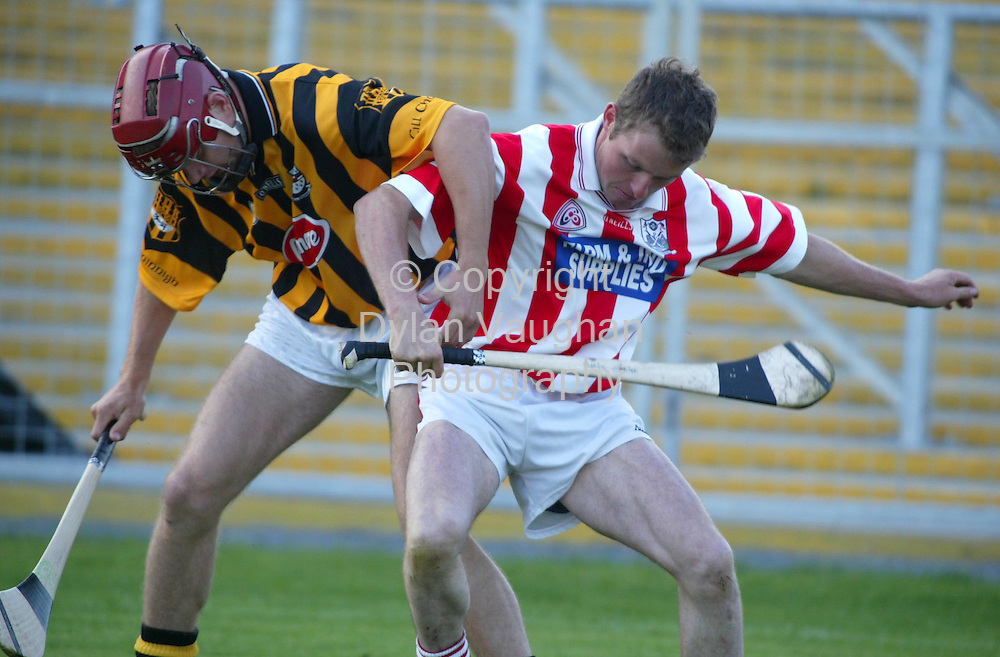 17/9/2003.Kilkennys Jimmy Coogan and Young Irelands Martin Carter pictured in action at the Goal challange match in Nowlan Park Kilkenny..Picture Dylan Vaughan