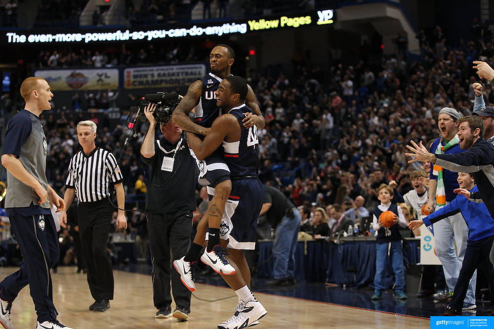 Rodney Purvis, lifts team mate Ryan Boatright, UConn, as they celebrate their sides victory at the end of the game during the UConn Huskies Vs Tulsa Semi Final game at the American Athletic Conference Men's College Basketball Championships 2015 at the XL Center, Hartford, Connecticut, USA. 14th March 2015. Photo Tim Clayton