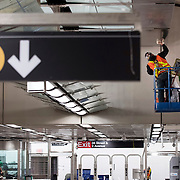 December 12, 2016 - New York, NY :  A worker cleans the ceiling in the 86th Street Second Avenue subway station on Monday morning. After years of delays, the new subway line is preparing to welcome its first straphangers. CREDIT: Karsten Moran for The New York Times