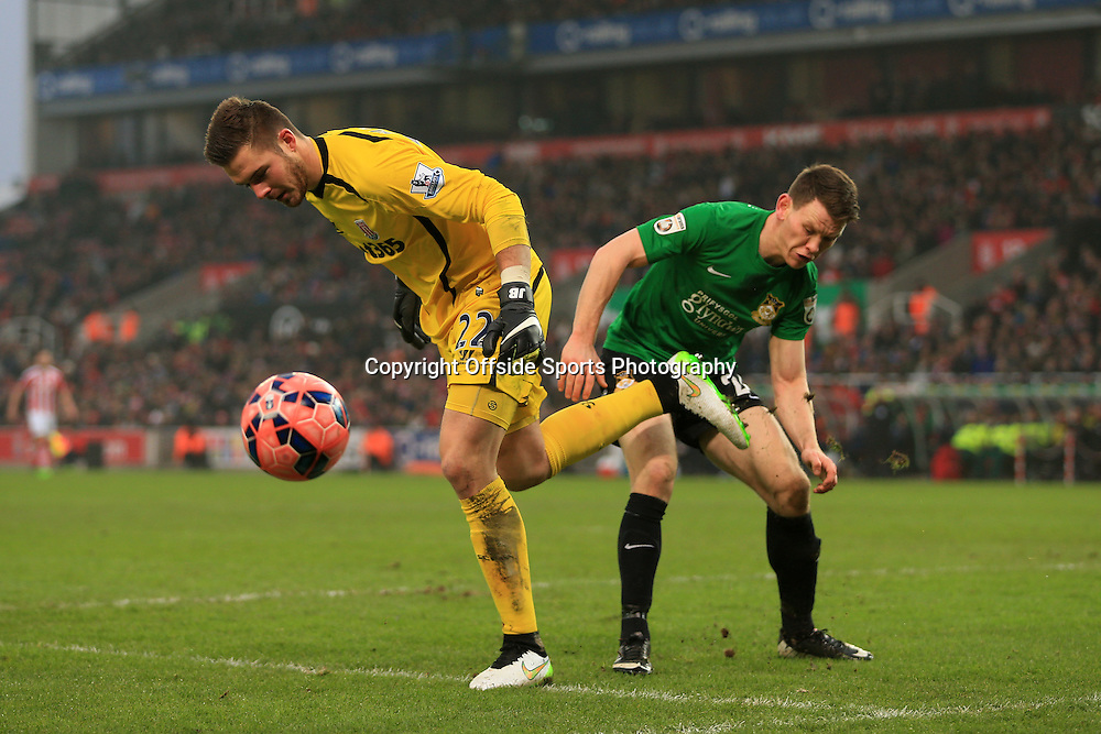 4th January 2015 - FA Cup - 3rd Round - Stoke City v Wrexham - Connor Jennings of Wrexham challenges Stoke goalkeeper Jack Butland - Photo: Simon Stacpoole / Offside.