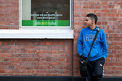 © licensed to London News Pictures. London, UK 15/02/2012. An unemployed young man, Amir Oznacar waiting outside a Jobcentre Plus in Victoria, London, as the number of young people without a job rose 22,000 to 1.04m, official figures have shown. Photo credit: Tolga Akmen/LNP