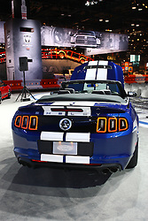 08 February 2012: 2013 Ford Shelby Mustang Cobra GT500...The most powerful Pony.5.8L supercharged V8 engine – 650 hp; the most powerful production V8 engine in the world*.Brembo 6-piston front brakes.Unique front end and aggressive splitter.Aluminum hood with heat extractors.Quad tip rear exit exhaust with new lower fascia applique.Interactive Launch Control.One-piece carbon fiber driveshaft.SVT Performance Package - 3.31 axle with TORSEN differential, unique wheels, R-Compound tires, SVT Engineered Bilstein cockpit-selectable dampers, unique front and rear springs, unique front and rear stabilizer bars, unique shift knob.SVT Track Pack - External oil cooler, transmission cooler with pump, differential cooler with pump.. Chicago Auto Show, Chicago Automobile Trade Association (CATA), McCormick Place, Chicago Illinois