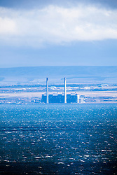 Cockenzie power station in East Lothian, Scotland. It is situated on the south shore of the Firth of Forth, as seen from the A921 near Burntisland, Fife.