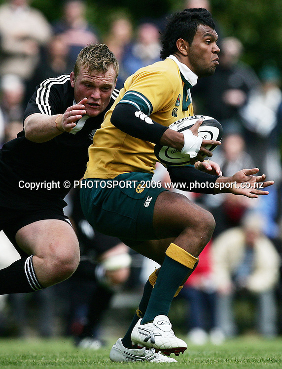Australian Secondary Schools captain and first five Kurtley Beale is tackled by New Zealand Secondary Schools flanker Luke Braid during the rugby match between the New Zealand Secondary Schools and the Australia Secondary Schools held at Auckland Grammar School in Auckland, New Zealand on Tuesday 10 October 2006. New Zealand Secondary Schools won the match 18 - 8. Photo: Tim Hales/PHOTOSPORT