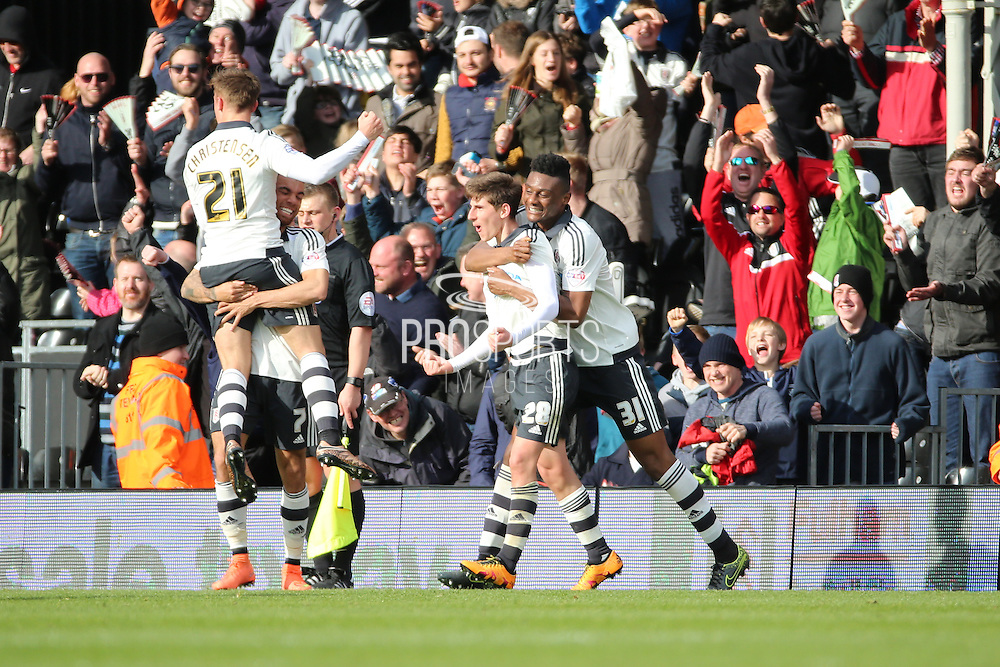 Fulham midfielder, Emerson Hyndman (28) celebrating scoring 2-1 during the Sky Bet Championship match between Fulham and Cardiff City at Craven Cottage, London, England on 9 April 2016. Photo by Matthew Redman.