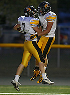 Vinton-Shellsburg's Max Kearns (7) celebrates his touchdown reception with Christopher Merchant (11) during the first half of their game between Vinton-Shellsburg and Benton Community at Benton Community High School in Van Horne on Friday evening, August 24, 2012.