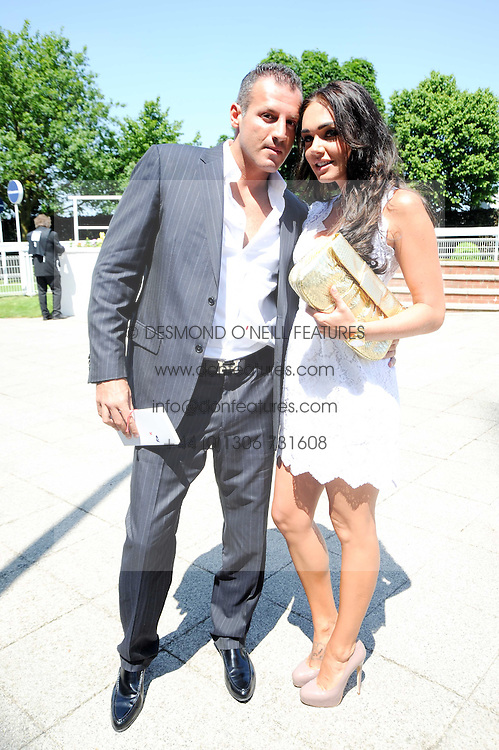 TAMARA ECCLESTONE and OMAR KHYAME at the Investec Ladies Day at Epsom Racecourse, Surrey on 4th June 2010.