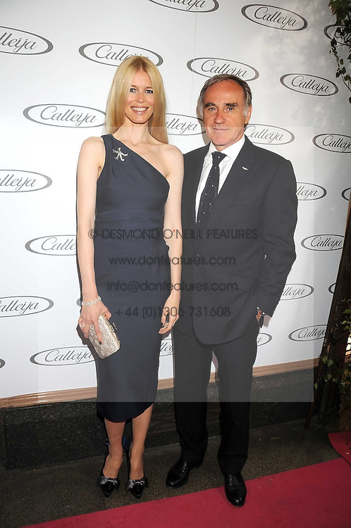 Australian award winning jewellery designer John Calleija and special guest Claudia Schiffer hosted the launch party of Calleija's new London store in the Royal Arcade, Old Bond Street, London on 24th June 2008.<br /><br />Picture shows:-  CLAUDIA SCHIFFER and Dr ULRICH BETZ Ceo of Aston Martin..