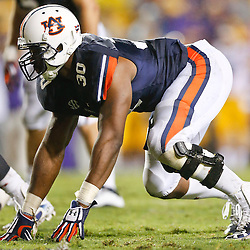 Sep 21, 2013; Baton Rouge, LA, USA; Auburn Tigers defensive end Dee Ford (30) against the LSU Tigers during the second half of a game at Tiger Stadium. LSU defeated Auburn 35-21. Mandatory Credit: Derick E. Hingle-USA TODAY Sports