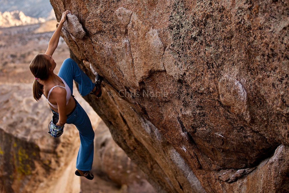 Climber Beth Rodden bouldering at the Buttermilk Boulders near Bishop California, USA.