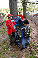 (from left) Aaron Cimprich, 13; Nathan Oxley, 19 and Albert Danner, 12 during a cleanup of the Victory Oak Knoll Memorial near the entrance of Dayton's Community Golf Course (at the edge of Kettering,) Saturday, May 7, 2011.  Boy Scout Troop 193 have been doing a cleanup here twice a year for several years.