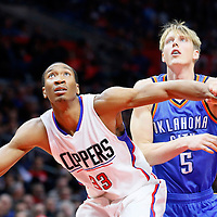 21 December 2015: Los Angeles Clippers forward Wesley Johnson (33) vies for the rebound with Oklahoma City Thunder forward Kyle Singler (5) during the Oklahoma City Thunder 100-99 victory over the Los Angeles Clippers, at the Staples Center, Los Angeles, California, USA.