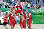 Sebastian Swiderski (L) and Pawel Pake (R) hold of Cezary Pazura (C) while exhibition match of Special Olympics Poland during Day 7 of the FIVB World Championships on July 7, 2013 in Stare Jablonki, Poland. <br /> <br /> Poland, Stare Jablonki, July 07, 2013<br /> <br /> Picture also available in RAW (NEF) or TIFF format on special request.<br /> <br /> For editorial use only. Any commercial or promotional use requires permission.<br /> <br /> Mandatory credit:<br /> Photo by © Adam Nurkiewicz / Mediasport