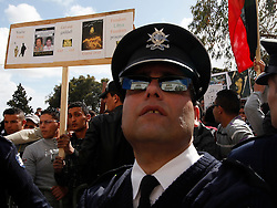 A police officer looks at the Libyan embassy as Members of the Libyan community in Malta protest against the Libyan government's crackdown on demonstrators in Libya, in Attard, outside Valletta, February 21, 2011..Photo by Darrin Zammit Lupi