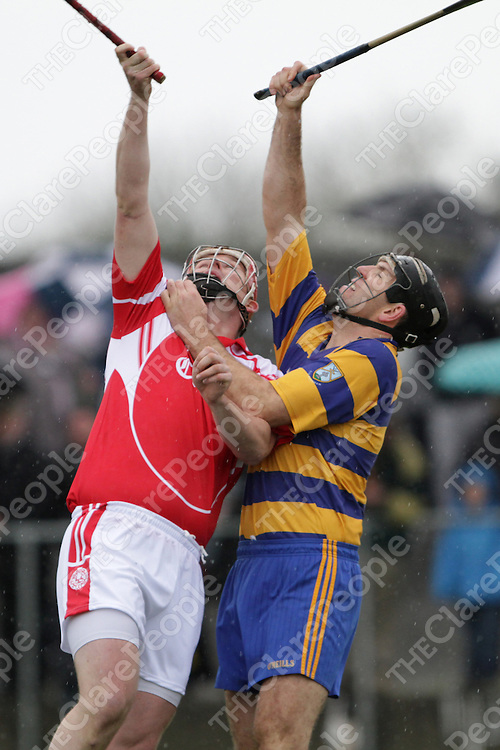 Eire &Oacute;g's Barry Nugent about to direct the ball to the net against Ruan's Niall O'Connor for the games only goal.<br /> Photograph by Flann Howard