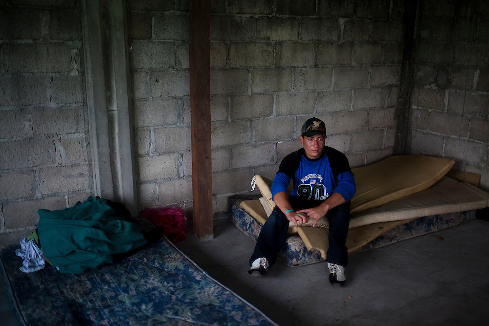 Jose Paz, 25, sits in a migrant shelter in Tenosique, Tabasco.  Tenosique is the starting point for migrants who will travel on top of a freight train north to the border with the United States. On a previous trip on the trains, Paz said he was kidnapped with over 100 other migrants, three of whom were shot and killed when their families were unable to pay the ransom. The trip for these migrants, mostly from Central America,  has become increasingly dangerous over the past several years as Mexico's drug war has raged and kidnappings and killings of migrants has increased.