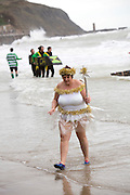 A Christmas fairy survives the sea for the 2016 Folkestone Lions club boxing day dip.  An annual fancy dress fundraising event, Sunny Sands, Folkestone. UK