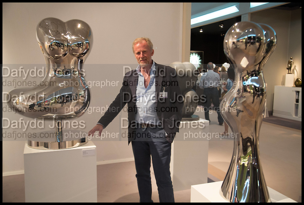 RICHARD HUDSON WITH HIS WORK AT THE LEILA HELLER GALLERY, Masterpiece London 2014 Preview. The Royal Hospital, Chelsea. London. 25 June 2014.
