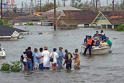 29 August, 2005. New Orleans, Louisiana.<br /> Hurricane Katrina hits New Orleans. Rescue workers frantically search for survivors in the rising flood waters of the 9th ward, bringing them to relevant safety on the elevated section of I-10  <br /> Photo; Charlie Varley.