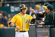Oakland Athletics catcher Stephen Vogt (21) celebrates with coaches after hitting a home run against Baltimore Orioles starting pitcher Kevin Gausman (39) during the fourth inning at Oakland Coliseum in Oakland, Calif. on August 8, 2016. (Stan Olszewski/Special to S.F. Examiner)