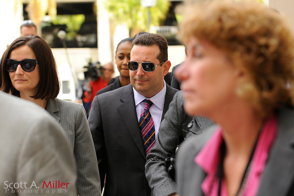 Defense Attorney Jose Baez (dark glasses) leaves after 1st degree murder trial of Casey Anthony was given to the jury at the Orange County Courthouse in Orlando, Florida July 4, 2011. Casey Anthony, 25, is accused of smothering her 2-year-old daughter Caylee with duct tape on June 16, 2008. ..©2011 Scott A. Miller