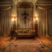 Religious crucifix by sofa in Hotel S in the Black Forest