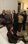 Mollie Dent-Brocklehurst, Joe La Placa and Henk Pijnenburg host an evening salon featuring the paintings of Aaron van Erp. Conway St. London. 9 December 2005.ONE TIME USE ONLY - DO NOT ARCHIVE  © Copyright Photograph by Dafydd Jones 66 Stockwell Park Rd. London SW9 0DA Tel 020 7733 0108 www.dafjones.com