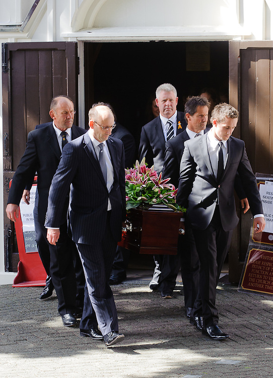 Michael James Bowie Hobbs' (Jock) coffin is carried from Old St Pauls Church by (l-r) Don Hayes, Peter Hobbs, Steve Tew, Rob Deans, Michael Hobbs, Wellington, New Zealand, March 18, 2012. Credit: SNPA / Mark Coote