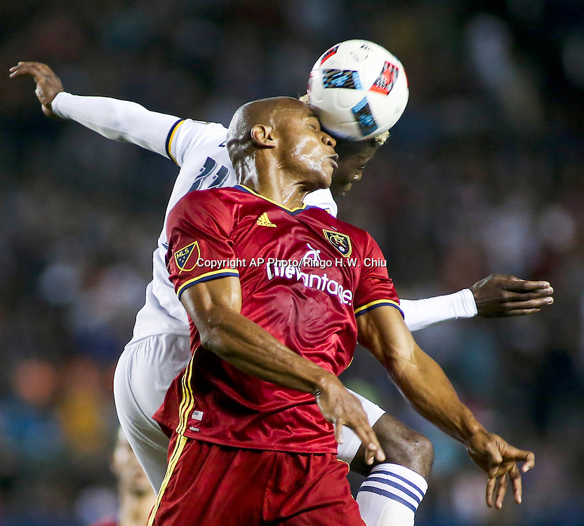 Real Salt Lake defender Jamison Olave, front and Los Angeles Galaxy forward Gyasi Zardes, back, battle for a head ball in the first half of an MLS soccer game in Carson, Calif., Saturday, April 23, 2016. (AP Photo/Ringo H.W. Chiu)
