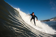 Mike Fox surfs in Oceanside, CA.