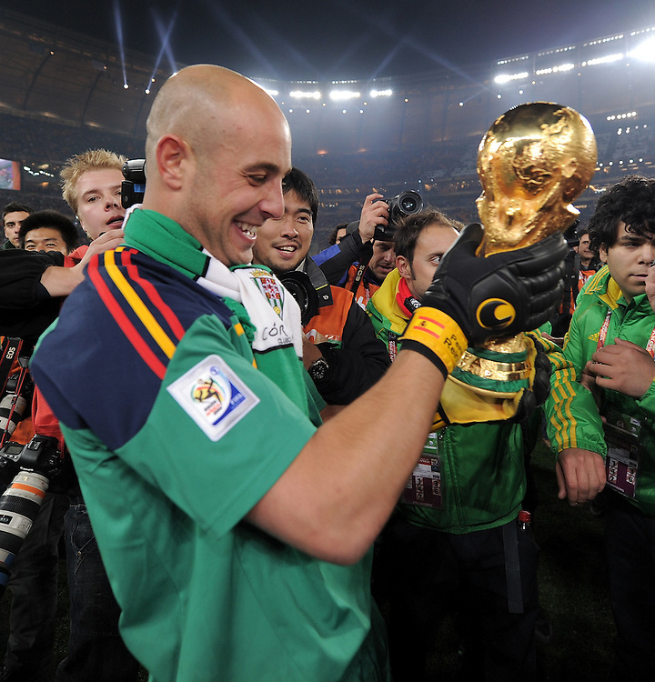 Pepe Reina celebrates with the cup after winning the 2010 FIFA World Cup South Africa Final match between Netherlands and Spain at Soccer City Stadium on July 11, 2010 in Johannesburg, South Africa.